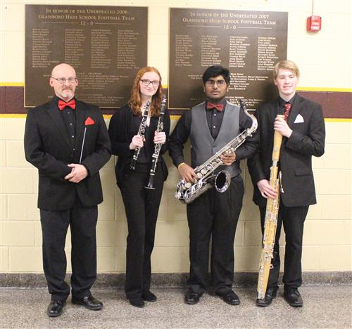 GHS Band Director Art Myers with All South Jersey honorees Alicia Petrany, Mayooran Mohanakanthan, and Logan Stockl.