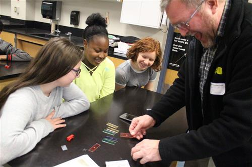 GIS students work on cell phone microscopes with Dale Josephson.