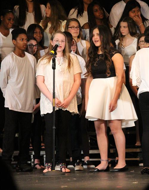 A picture of a choral duet.