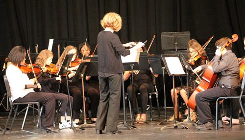 The orchestra is pictured.