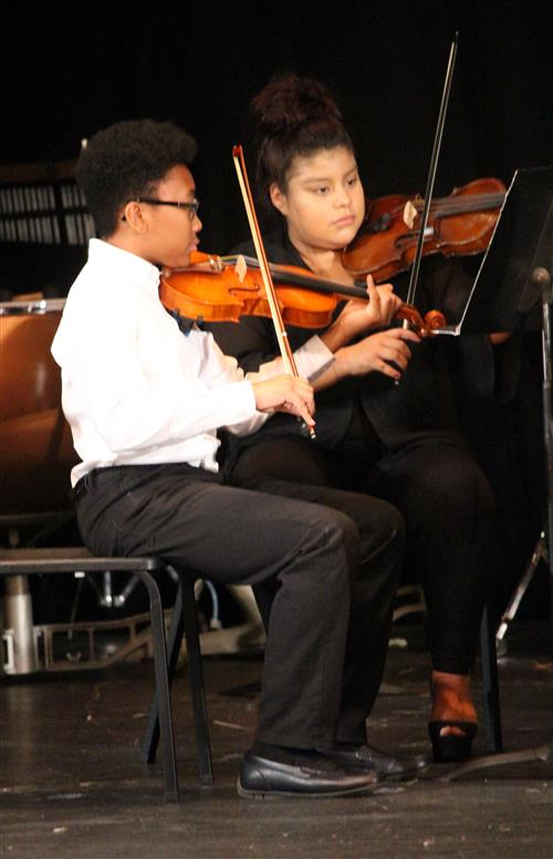 Two orchestra students are pictured.