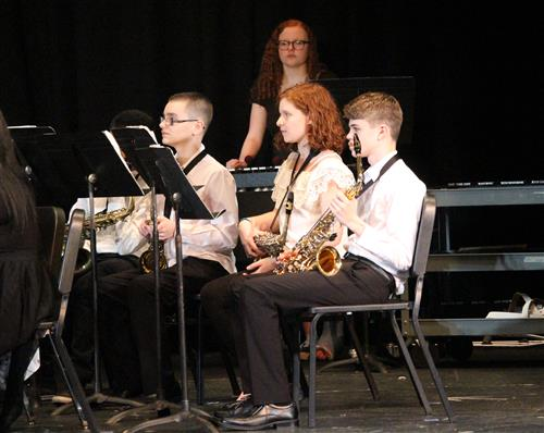 Saxophonists and a keyboardist are pictured here.