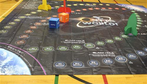 "This picture shows the ""Outta This World!™"" game board."