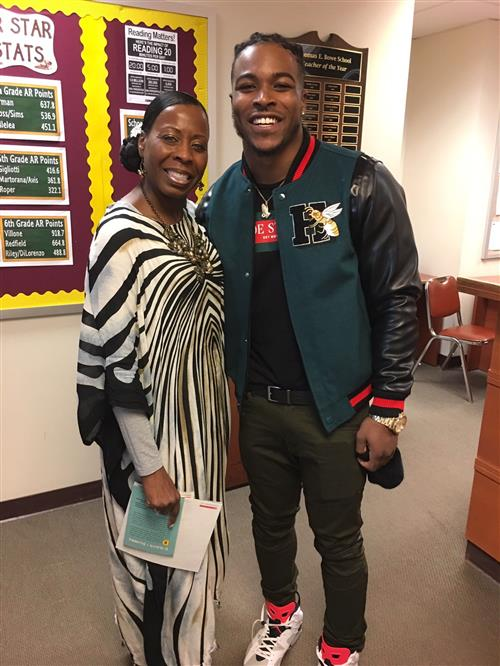 Teacher Cyndy Wiggins poses with Corey Clement.