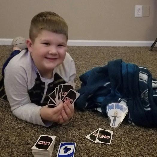 Second-grader Zachary K. playing Uno with the cutout