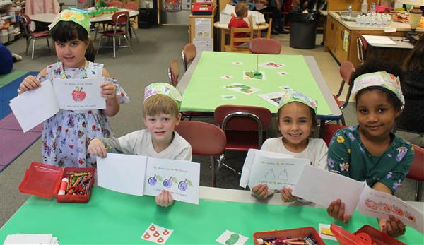 Students are shown with their Hungry Caterpillar Booklets.