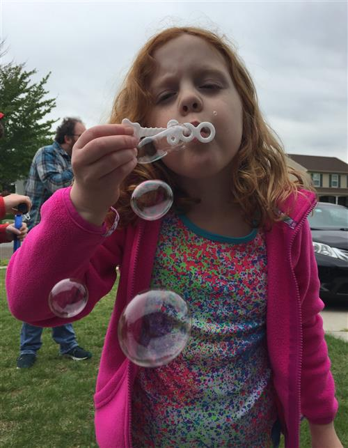 Molly Smith pictured blowing bubbles
