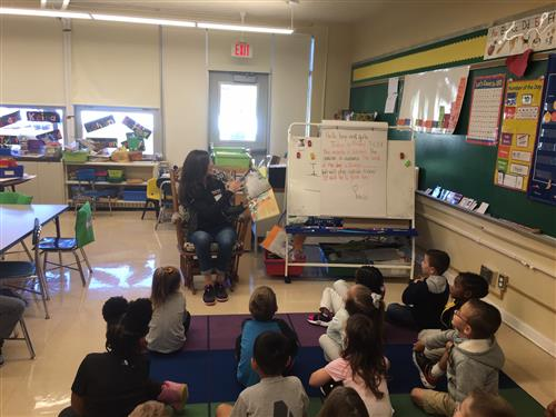 Parent Allison Rue reads to Amy Witkoski's class.