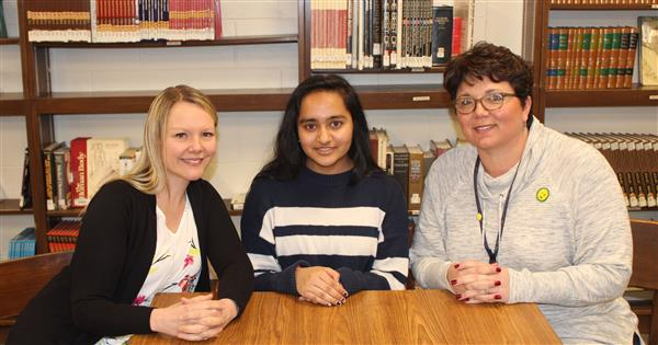 Pariti Sutaria is shown with NHS adviser Alexis George and Principal Danielle Sneathen.
